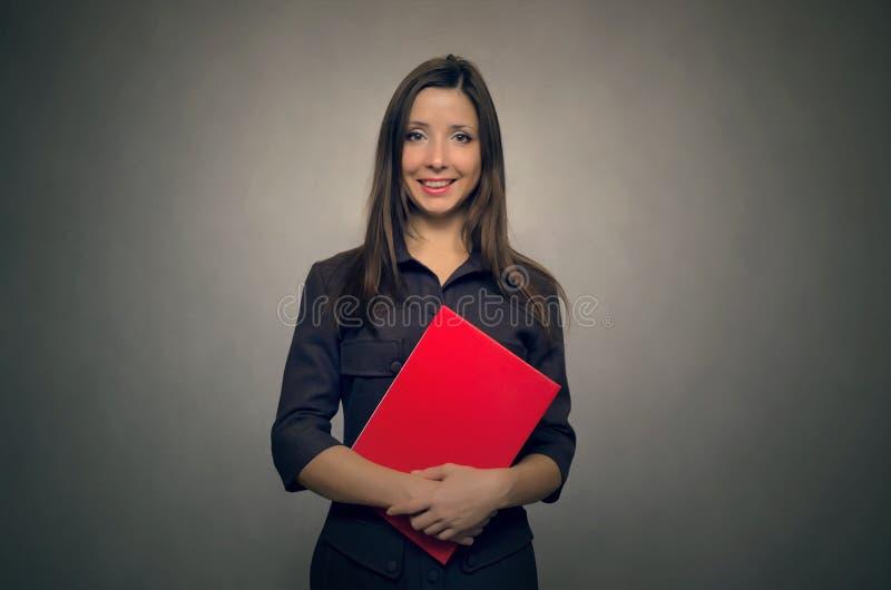 Professeur avec un journal de classe secrétaire photo libre de droits