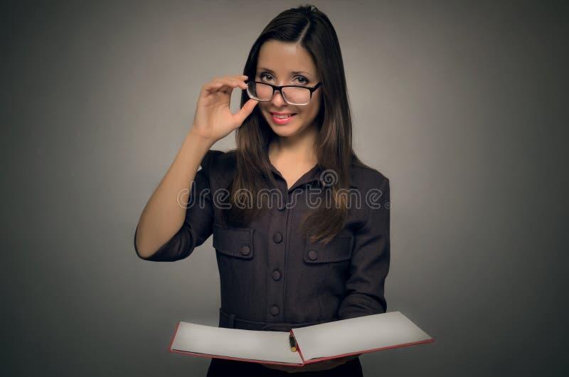 Professeur avec un journal de classe secrétaire image libre de droits