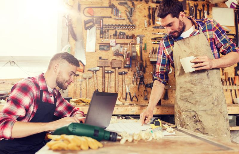 Carpenters with laptop and blueprint at workshop stock image image download carpenters with laptop and blueprint at workshop stock image image of business craft malvernweather Image collections