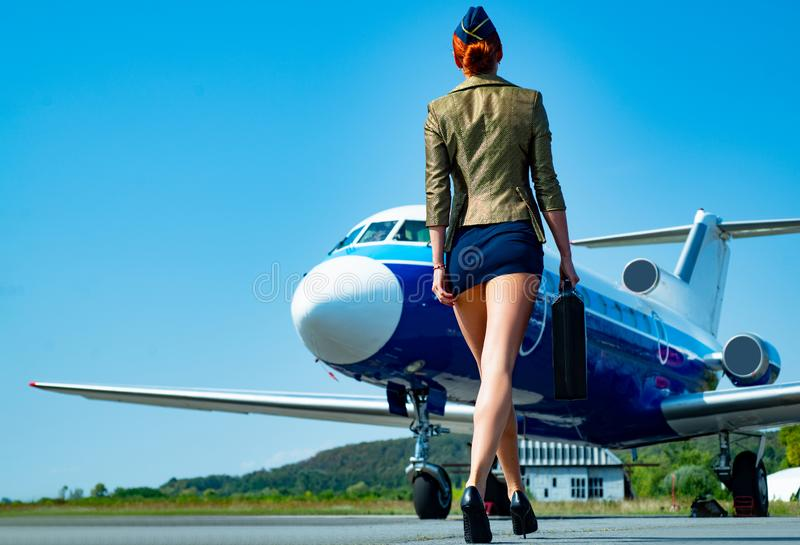 Profession stewardess. Air hostess. Female flight attendant. Air stewardess. Travel concept. Commercial airplane flying. With beautiful charming stewardess. Fly royalty free stock photos
