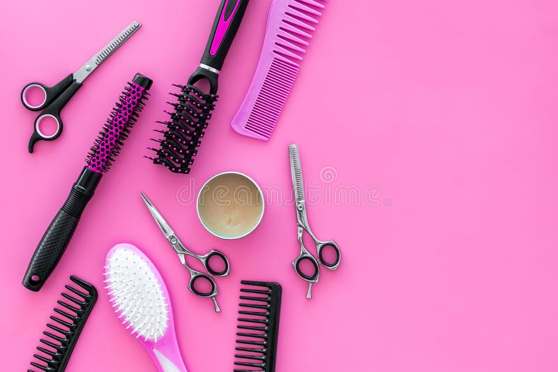 Professional accessories of hairdresser on work desk pink background top view space for text stock image