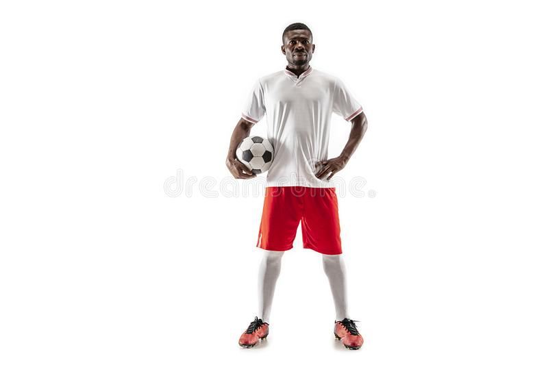 Professional african football soccer player isolated on white background. Professional african american football soccer player standing isolated on white studio royalty free stock photography