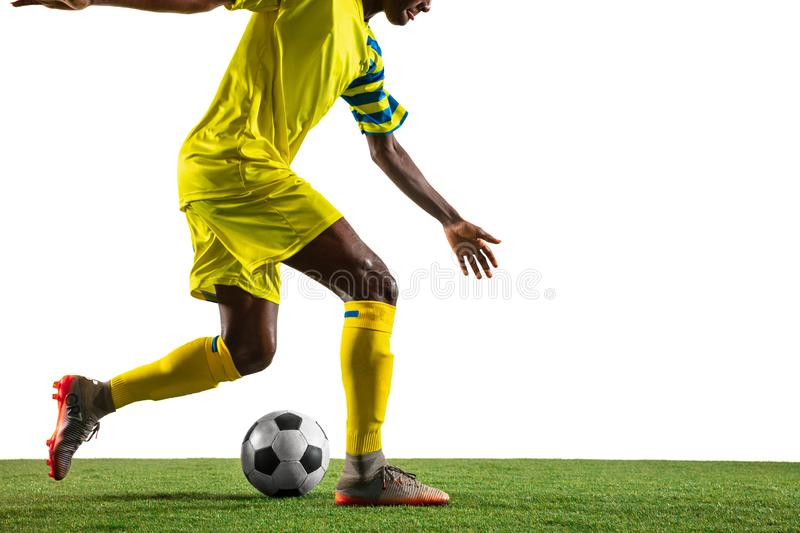 Professional african football or soccer player isolated on white background stock photo