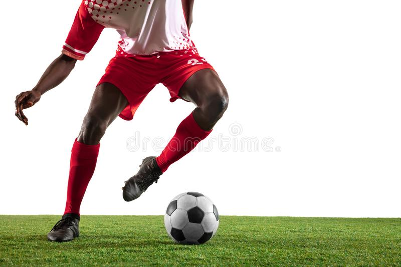 Professional african football or soccer player isolated on white background stock photography