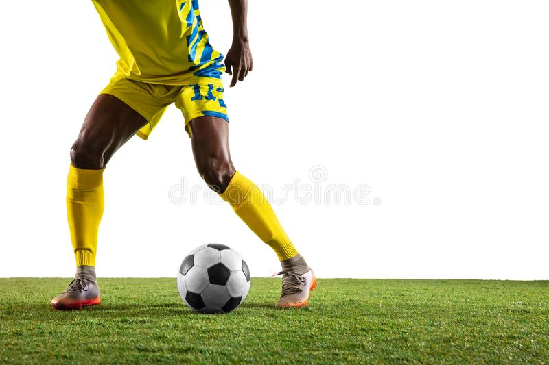 Professional african football or soccer player isolated on white background stock photos
