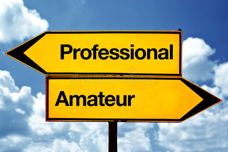 Professional or amateur. Opposite signs. Two opposite road signs against blue sky background stock photos