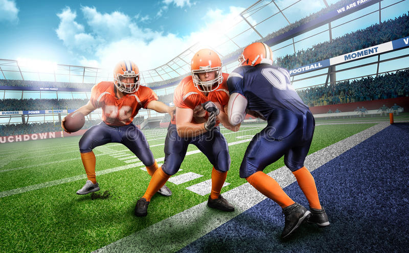 Professional american football player in action on stadium stock photos