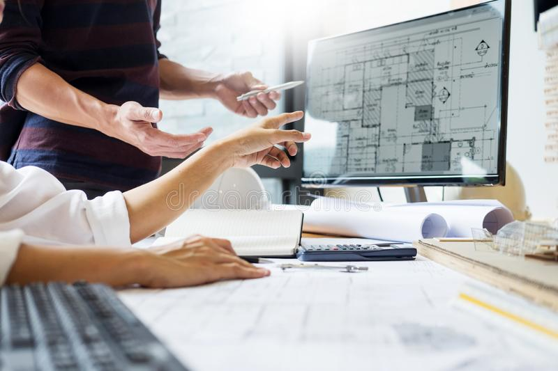 professional architect designer structural engineer team colleagues working office looking computer discussing building plan royalty free stock images