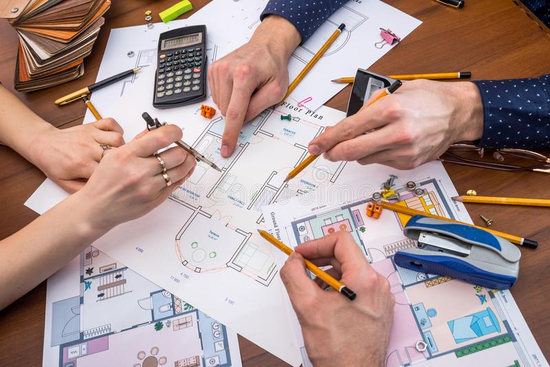 Professional architects discussing the house project. With work tools stock photo