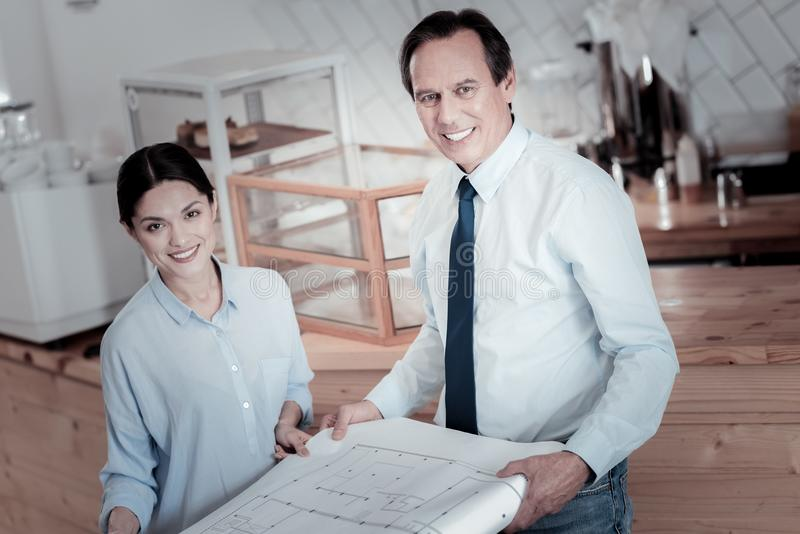 Professional architects feeling happy while getting new ideas stock image