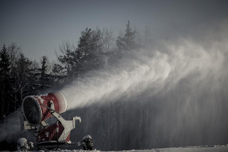 Professional artificial snow machine making snow stock images
