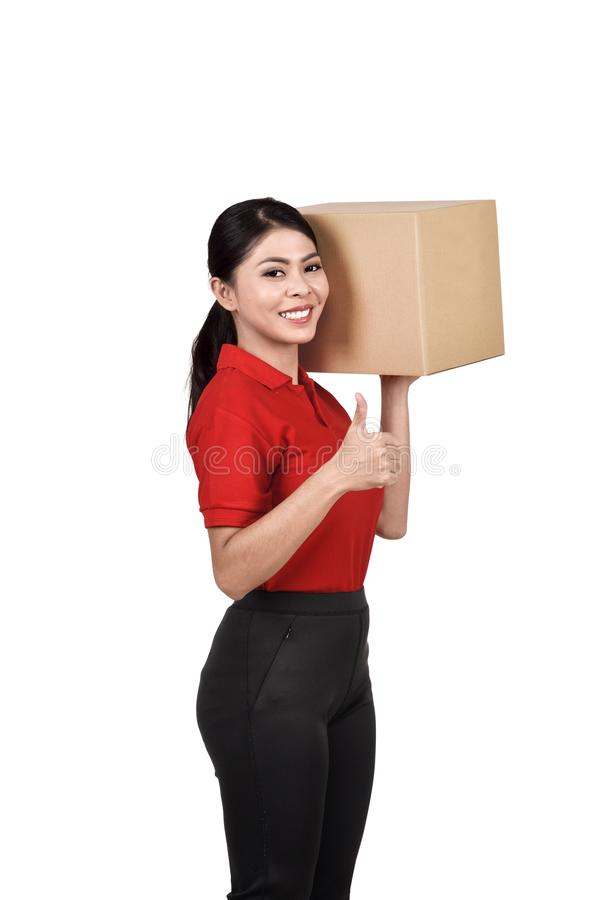 Professional asian delivery woman bring the cardboard box stock photo