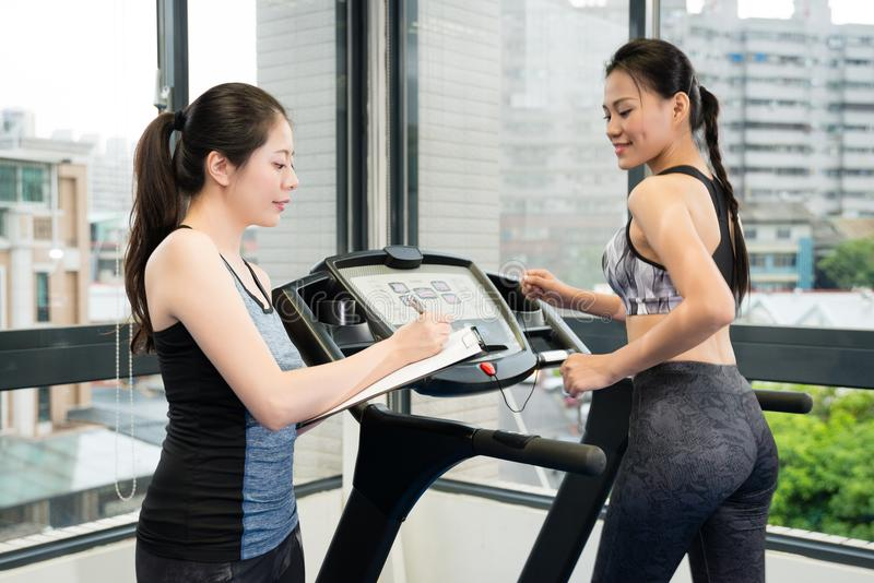 Professional Asian woman personal fitness coach royalty free stock photos