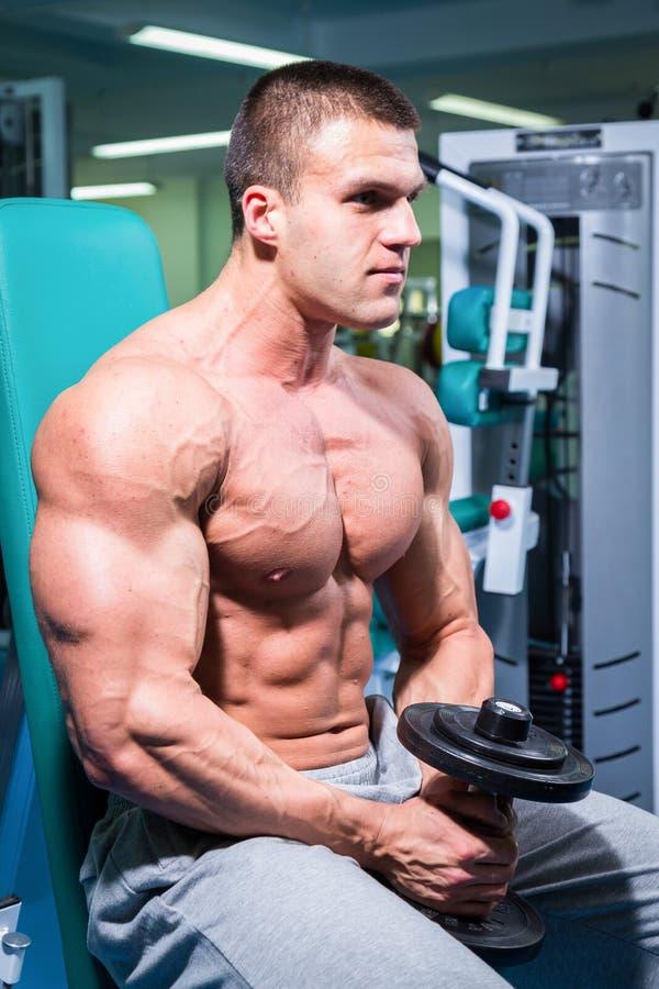 Fitness Man Doing Stomach Workouts On Horizontal Bar