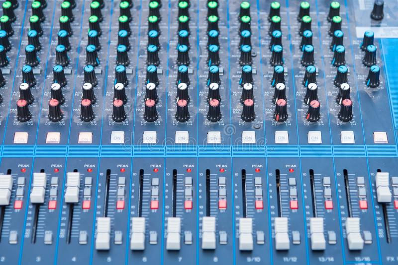 Professional Audio dj mixer console, sound tools and gear, studio equipment picture, selective focus. Sliding jockey male party knob tone entertainment royalty free stock photos