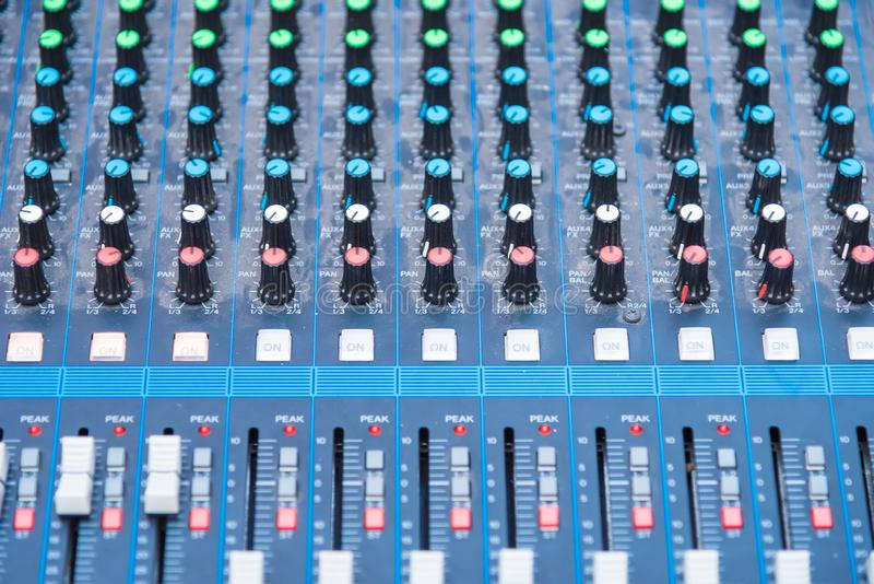 Professional Audio dj mixer console, sound tools and gear, studio equipment picture, selective focus. Sliding jockey male party knob tone entertainment stock image