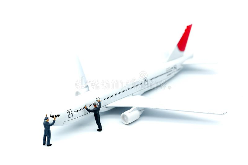 Miniature people : worker or Housewife cleaning on air plane using for business trip concept. stock photos