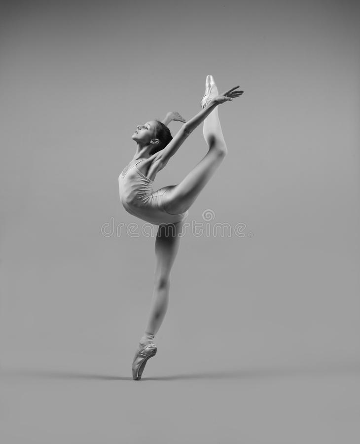 Ballerina Аttitude. The professional ballerina in pointe shoes in a pose attitude stock photography