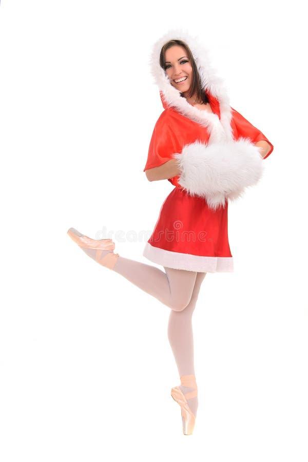 Professional ballerina tiptoe in Christmas dress royalty free stock photo