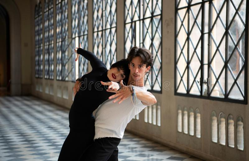 Professional ballroom dancers dancing passionately while practicing alone royalty free stock photos