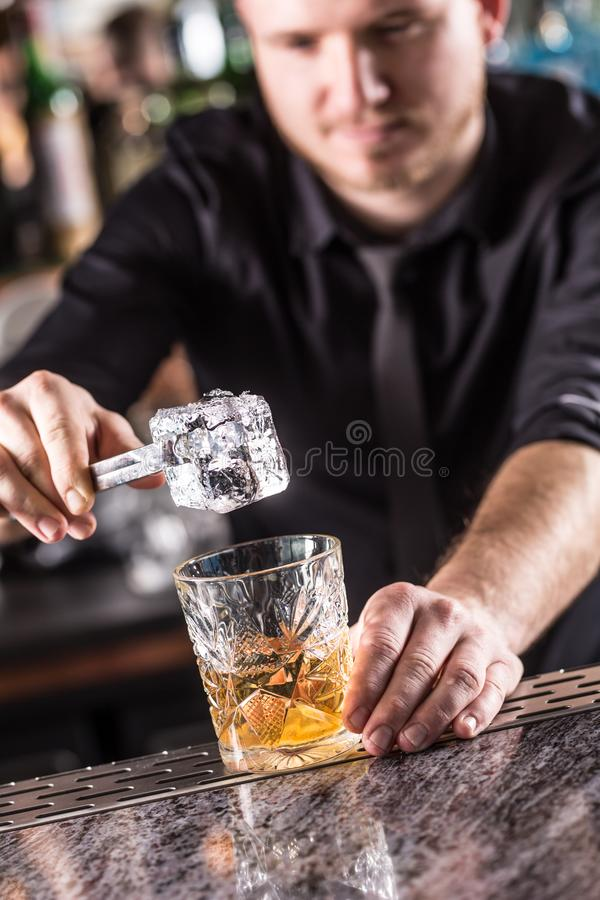 Professional barman making alcoholic cocktail drink old fashioned stock image