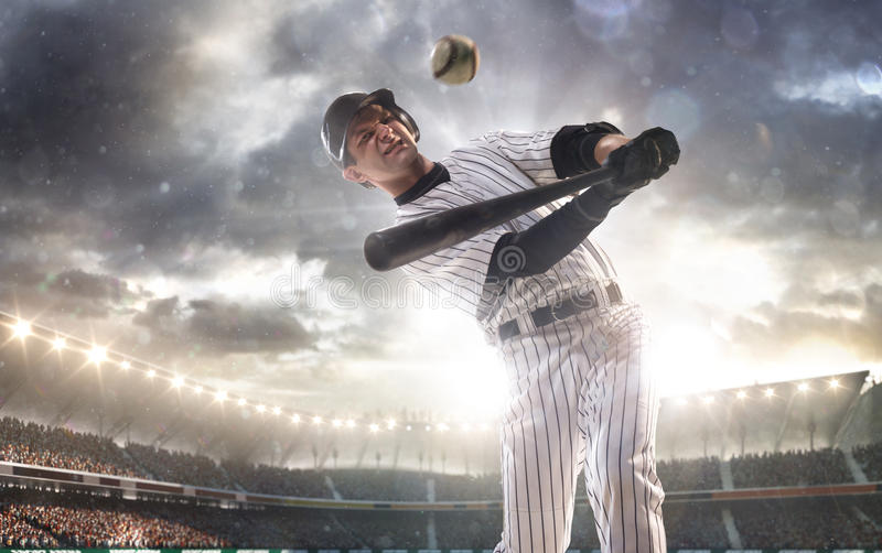 Professional baseball player in action. On grand arena royalty free stock photography