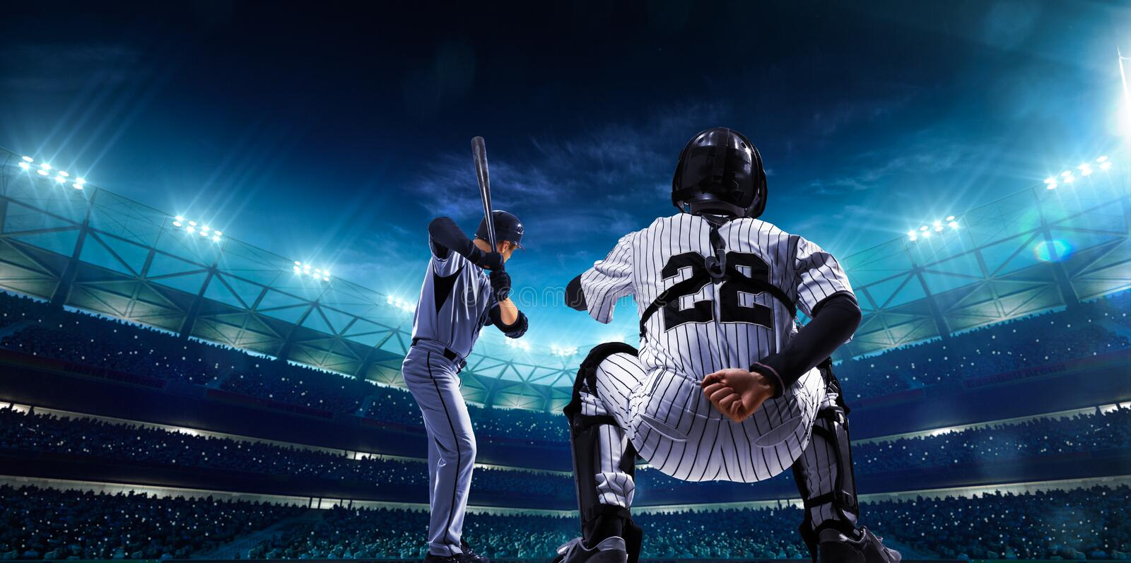 Professional baseball players on night grand arena stock photography