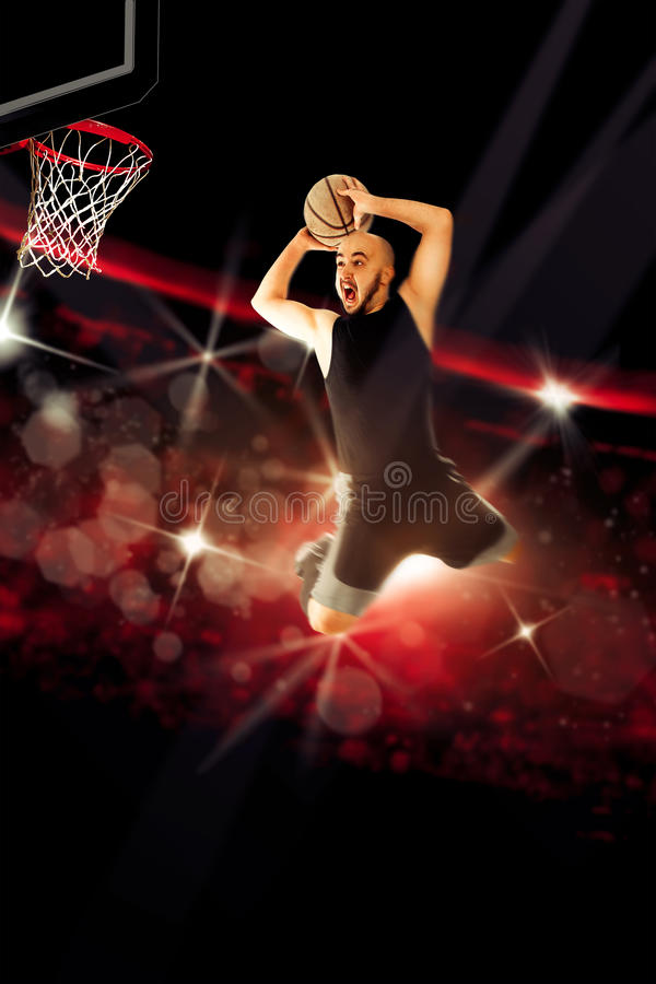 Professional basketball player makes a slam dunk in the game. NBA. Basketball game. Sportsman playing basketball royalty free stock image