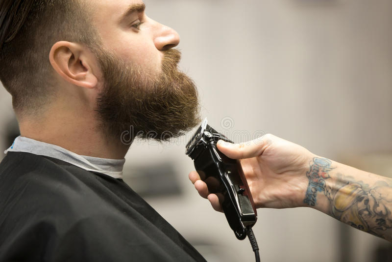 Professional beard grooming at barbershop stock photo