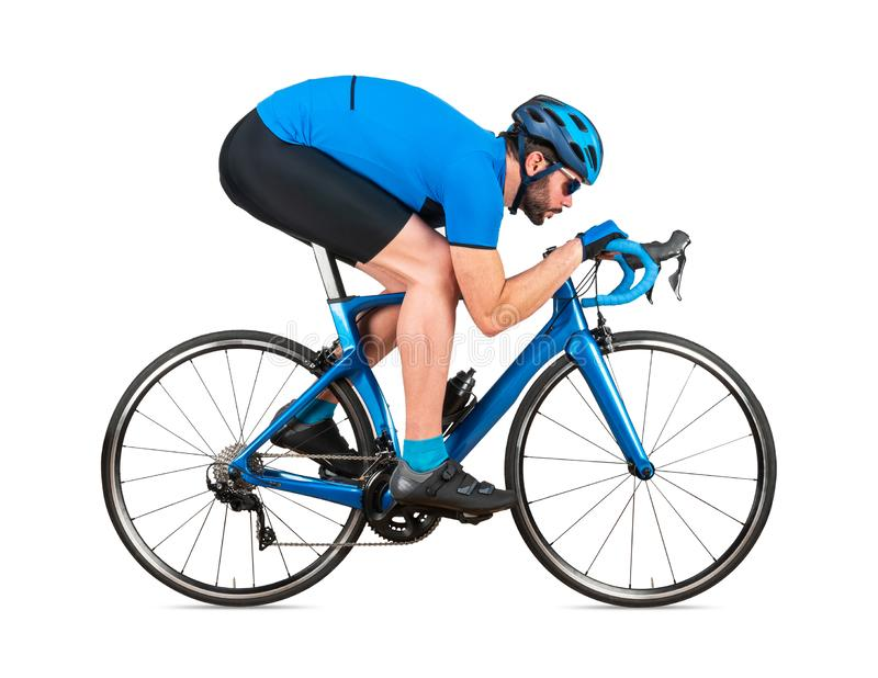 Professional bicycle road racing cyclist racer  in blue sports jersey on light carbon race in aerodynamic downhill descent. Position. sport training cycling royalty free stock photos