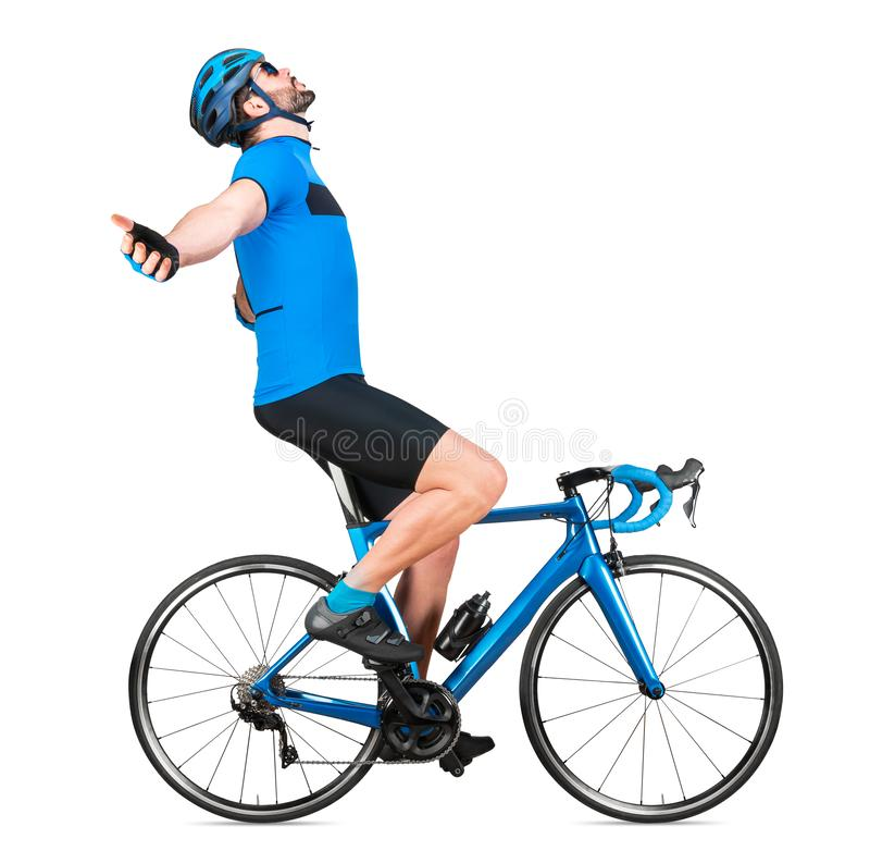 Professional bicycle road racing cyclist racer in blue sports jersey on light carbon race cycle celebration celebrating win. sport. Exercise training cycling stock photography
