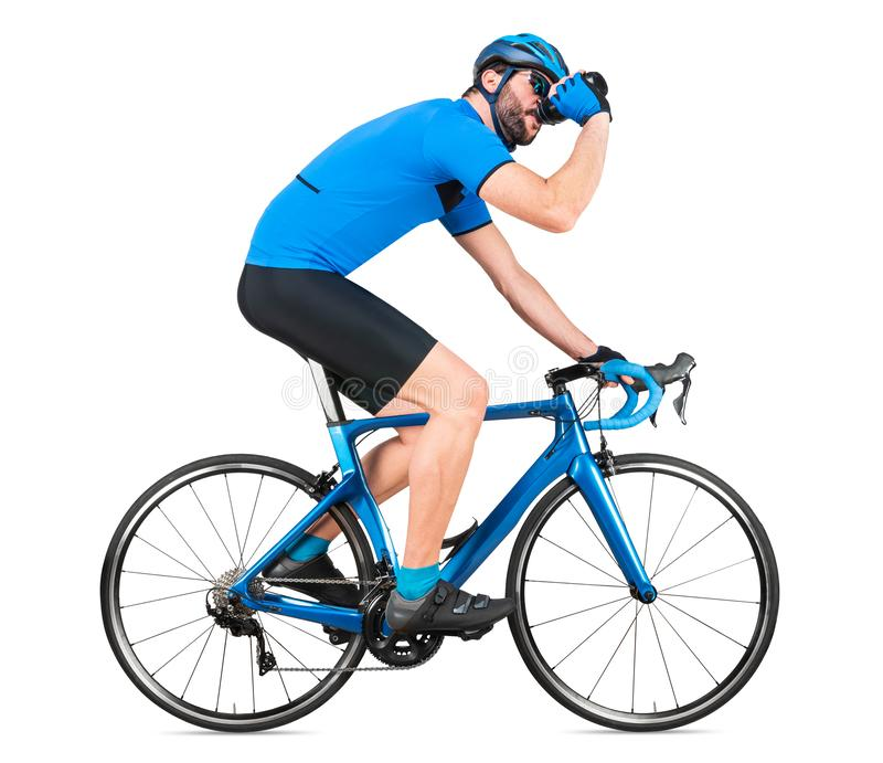 Professional bicycle road racing cyclist racer  in blue sports jersey on light carbon race drinking out of water bottle. sport. Training cycling concept royalty free stock photo