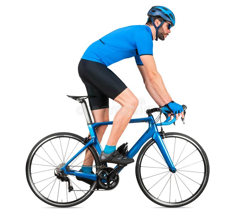 Professional bicycle road racing cyclist racer  in blue sports jersey on light carbon race out of the saddle ascent uphill. Climbing position, sport training royalty free stock photos