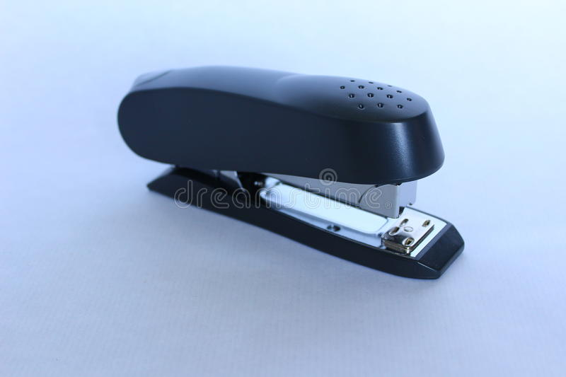 A professional black office stapler stock images