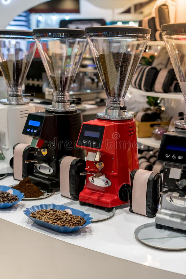 Professional black and red electric grinders on table stock photos