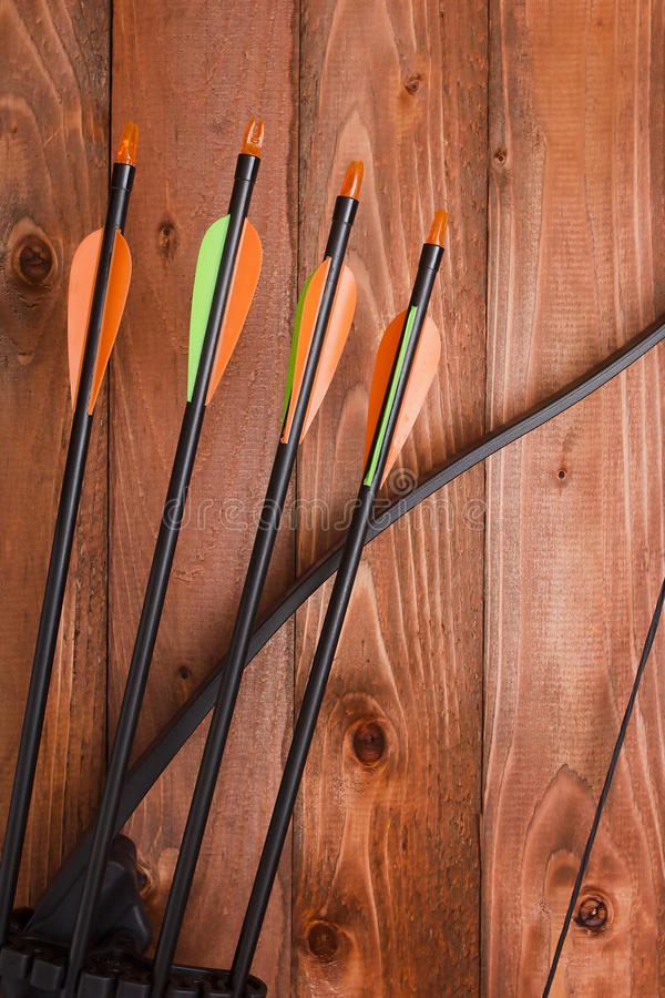 Professional bow with a set of arrows. A professional bow with a set of arrows for hunting and sports stock photography