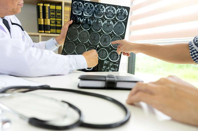 professional brain doctor give a counselor to the patient stock images