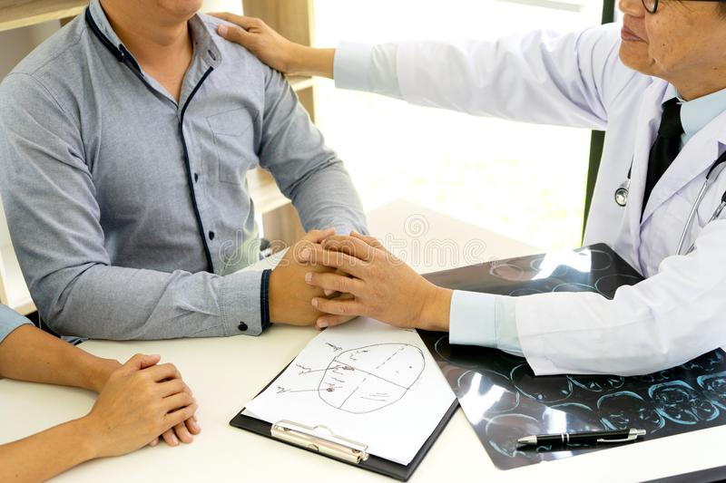 Professional brain doctor give a counselor to the patient. And tell the detail to help for good health, Stethoscope Medical instruments are on the table stock photo