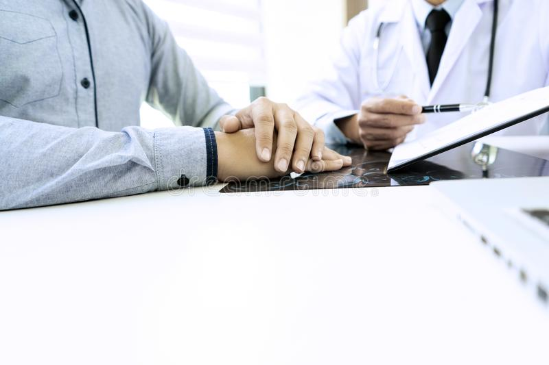 Professional brain doctor give a counselor to the patient. And tell the detail to help for good health, Stethoscope Medical instruments are on the table, advice royalty free stock photography