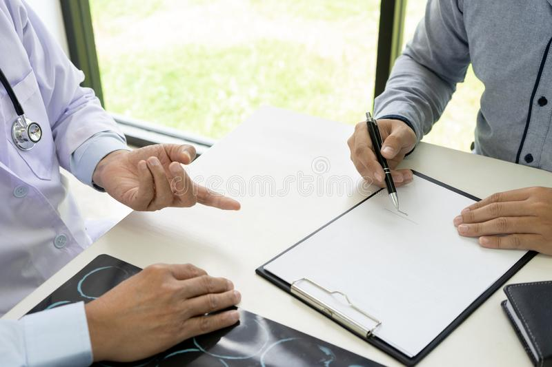 Professional brain doctor give a counselor to the patient. And tell the detail to help for good health, Stethoscope Medical instruments are on the table, advice stock image