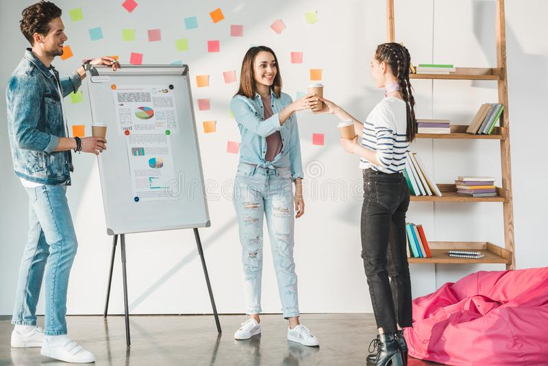 Professional business colleagues man and women sharing coffee and working together royalty free stock photo