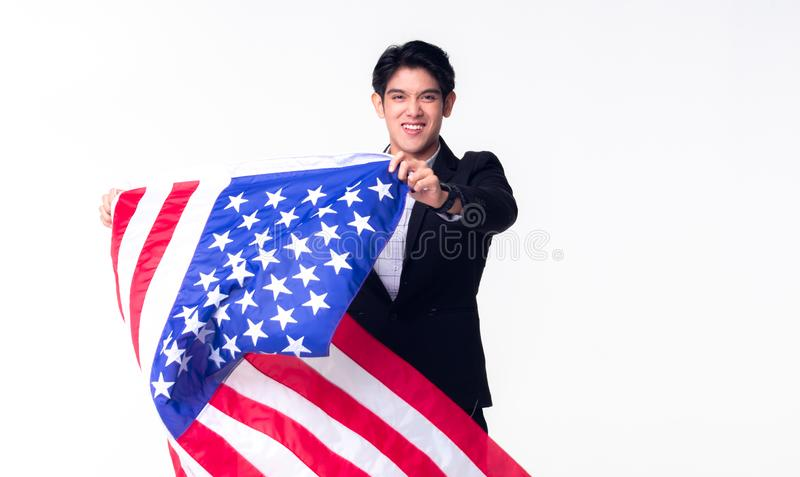 A professional business man is waving American USA flag on the white background stock images
