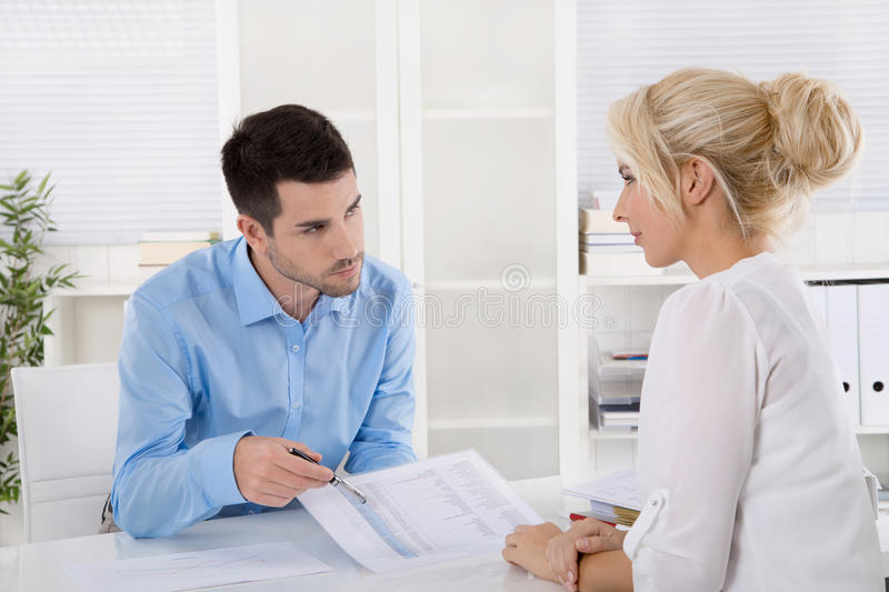 Professional business meeting: customer and advicer analyzing financial situation. stock image