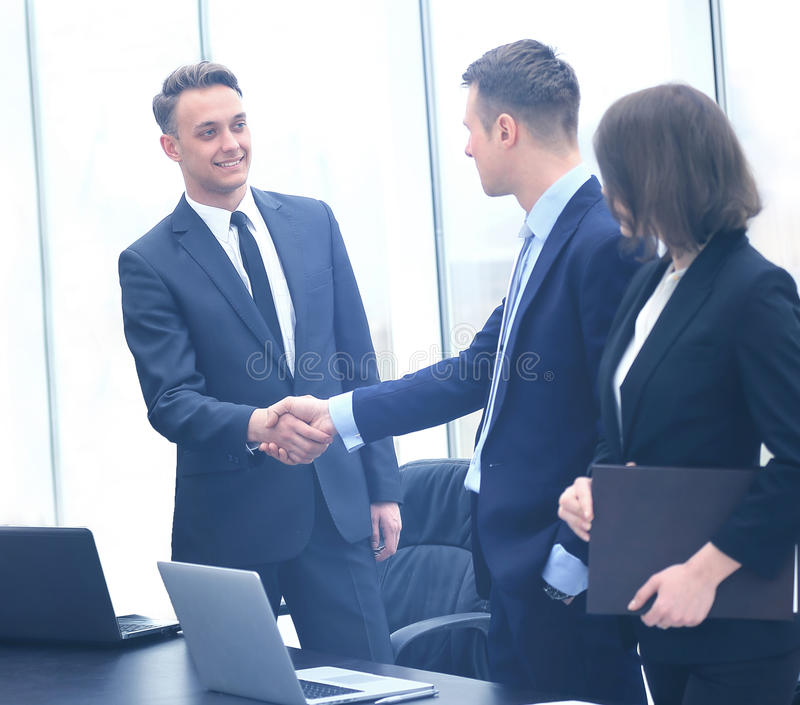 Professional business people shaking hands royalty free stock photo