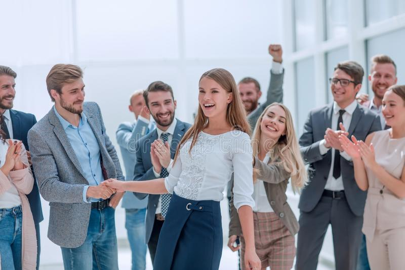 Professional business team congratulating their leader. photo with space for text stock photos