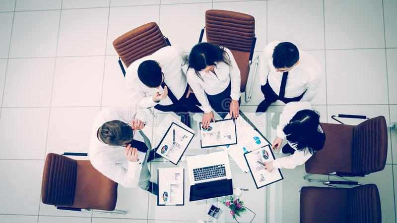 Professional business team developing a new financial strategy. Top view is a professional business team developing a new financial strategy of the company at a stock photo