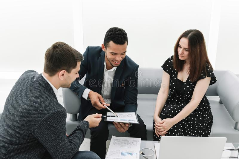 Professional business team discussing new work plan. Photo with copy space stock images
