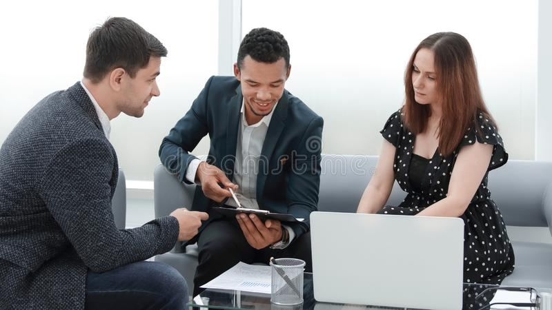 Professional business team discussing new work plan. Photo with copy space royalty free stock image