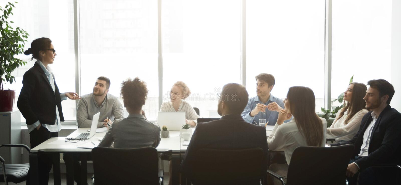 Professional business team having brainstorm meeting, panorama stock images