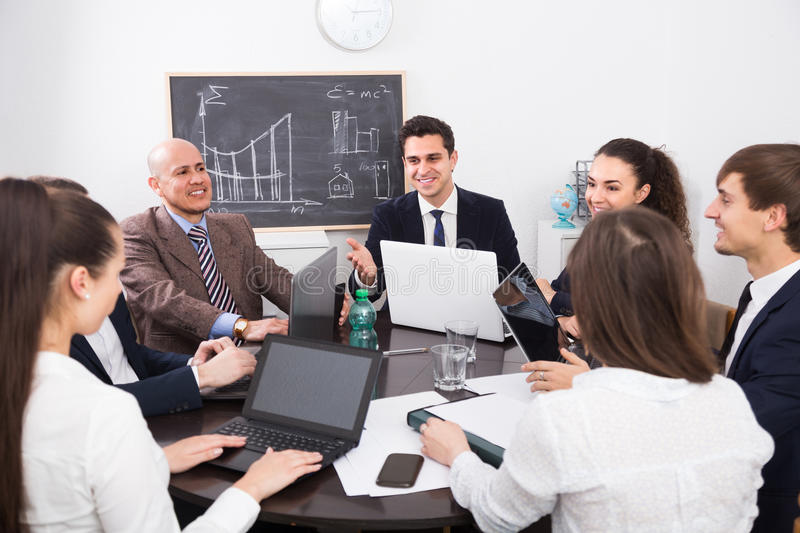 Professional business team at meeting stock image